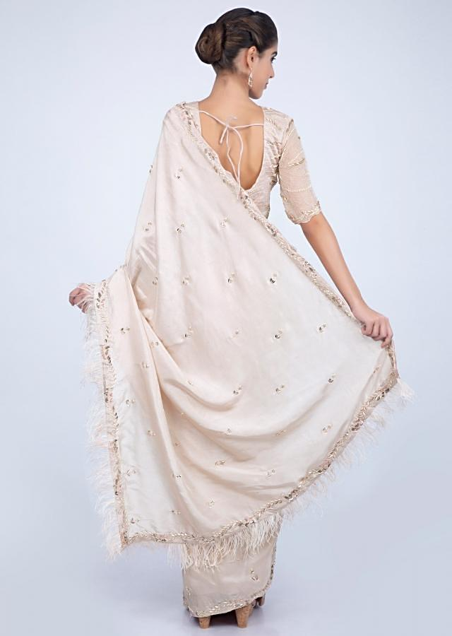 Ivory Saree With Embroidery And Feathers On The Border Online - Kalki Fashion