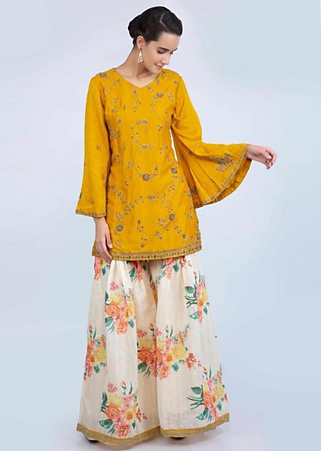 Mustard Suit With Embroidery Teamed With Floral Printed Cream Palazzo And Contrasting Dupatta With Stripes Online - Kalki Fashion
