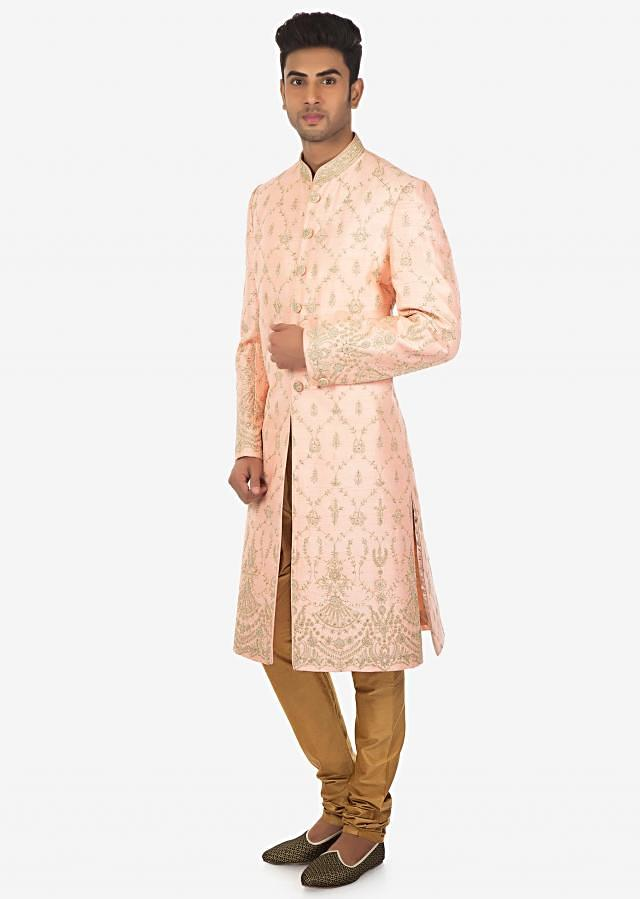 Embroidered Apricot Sherwani and Sandal Brown Solid Churidar Set on Kalki