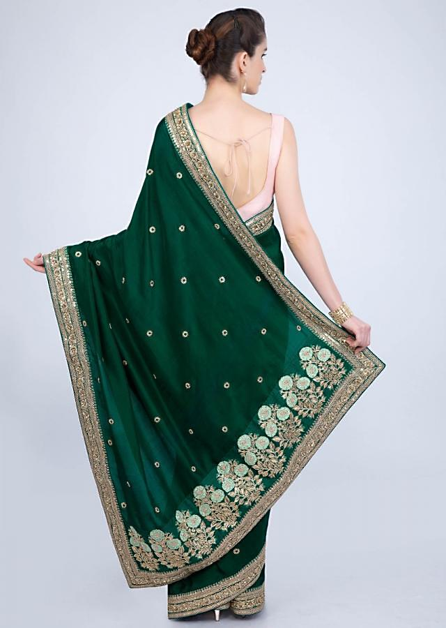 Emerald green crepe silk saree with embroidered butti and border only on kalki