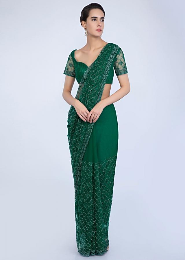 Emerald green hard net saree with heavy jaal embroidery only on Kalki