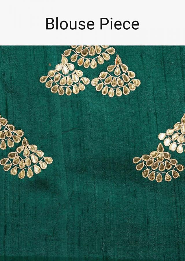 Emerald green organza saree with embroidered butti and golden border only on Kalki