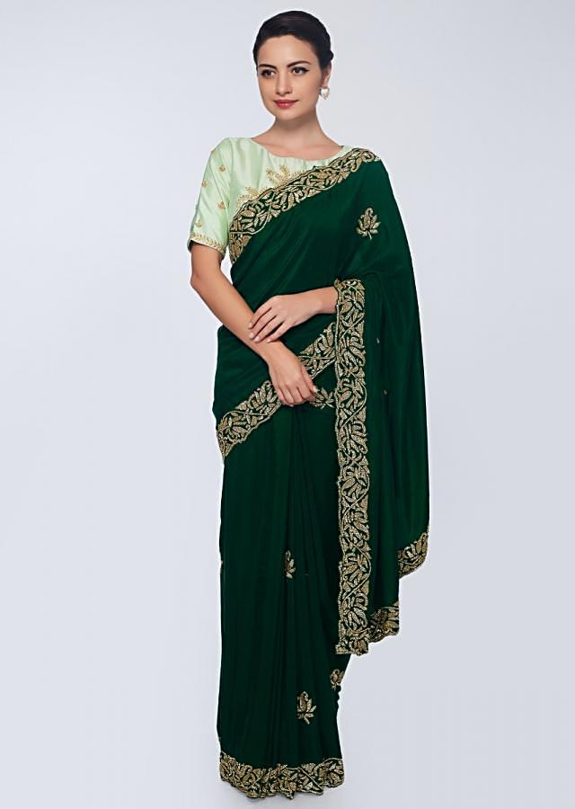 Emerald green satin saree embellished with cut dana embroidered butti and border only on Kalki