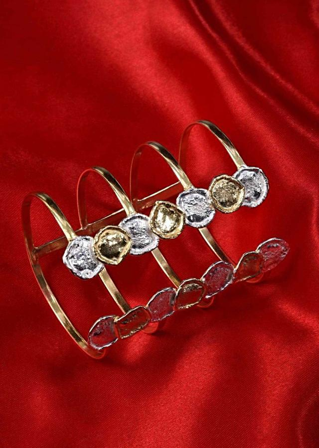 Fancy party wear kada with silver and gold disks at the edges only on Kalki