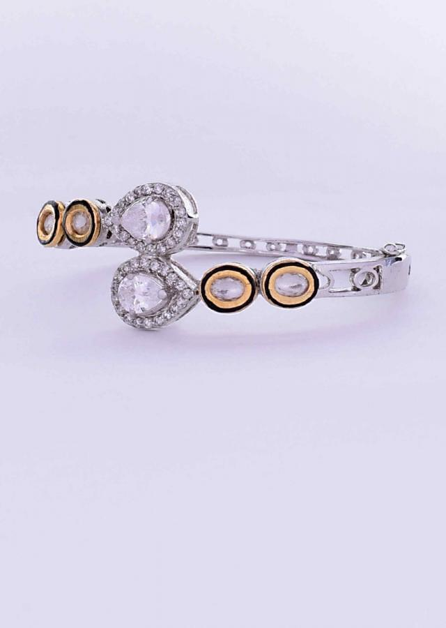 Fancy party wear silver kada with kundan and diamond adorning its look only on Kalki