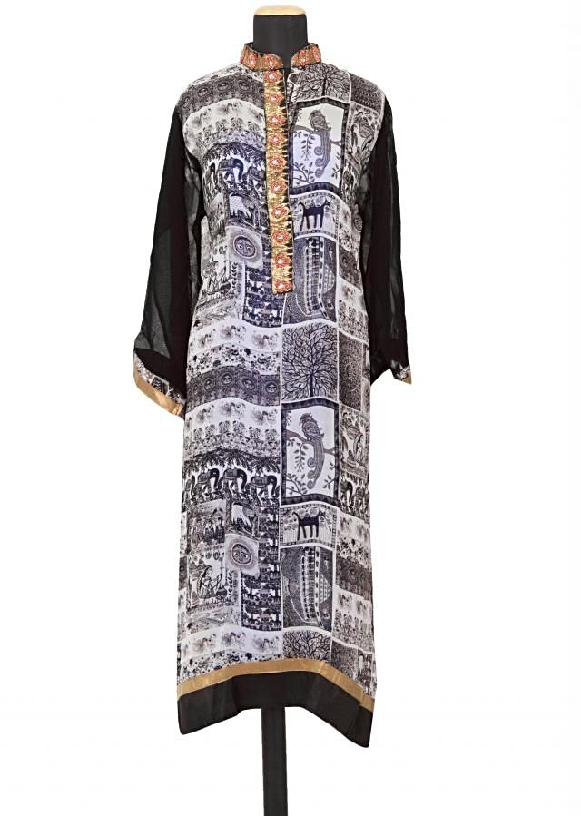 Featuring a black and white printed straight fit semi stitched salwar kameez embellished in zardosi and motti only on Kalki