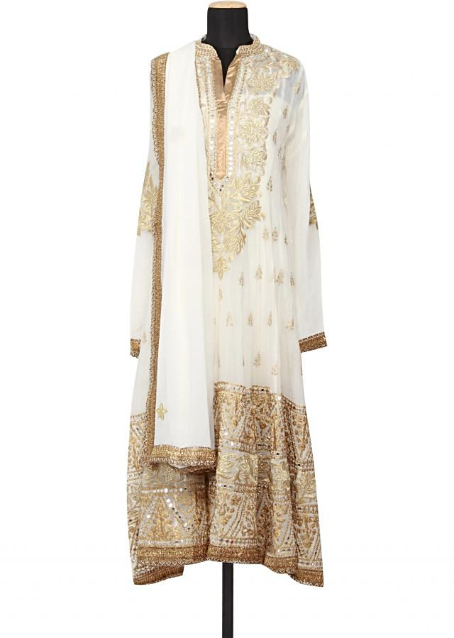 Featuring a georgette off white anarkali semi stitched embellished in zari and mirror work only on Kalki