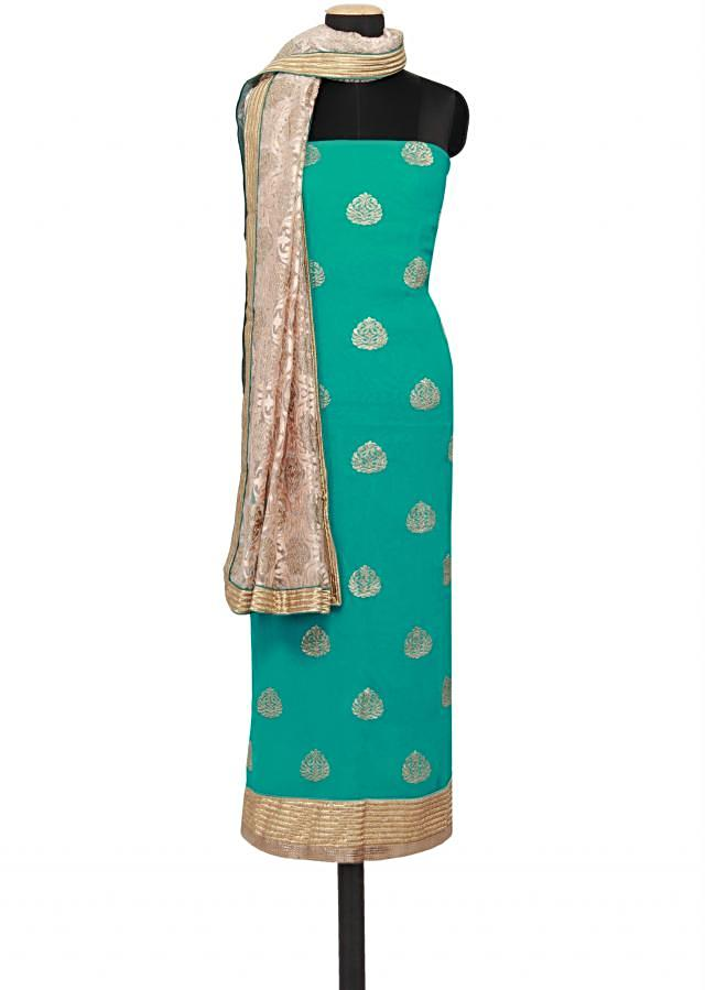 Featuring a green georgette unstitched salwar kameez embellished in gold zari embroidery only on Kalki