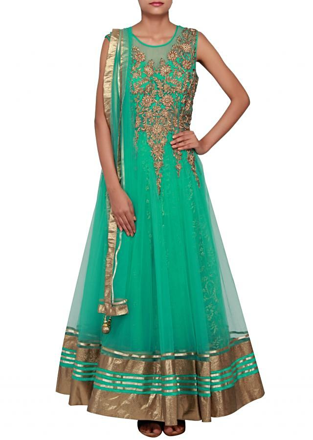 Featuring a mint net anarkali embellished in gold zari and kundan work only on Kalki