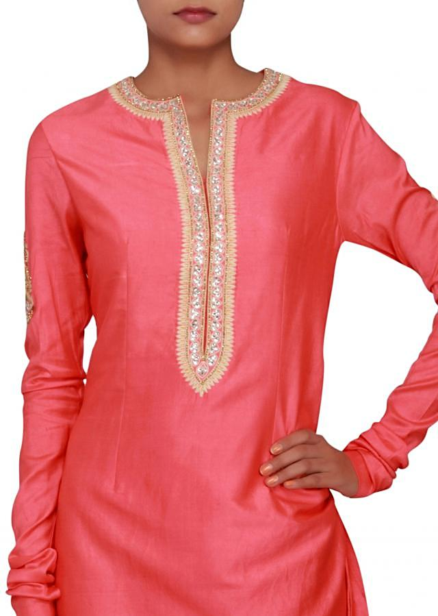 Featuring a peach silk straight fit suit embellished in kundan and thread work only on Kalki