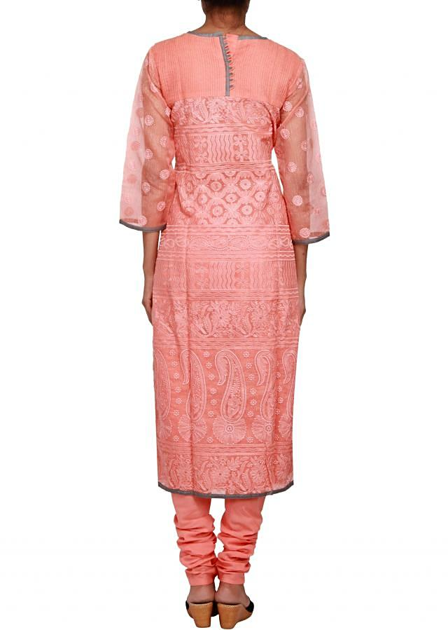 Featuring a peach straight fit suit in jute embellished in lucknowi work only on Kalki