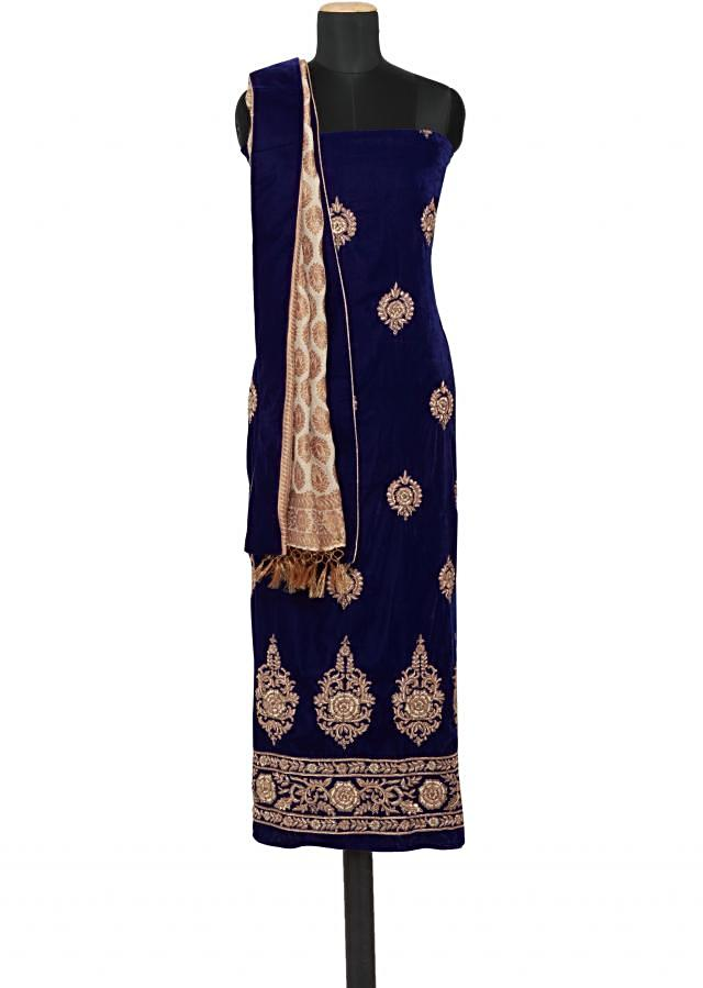 Featuring a royal blue velvet unstitched salwar kameez embellished in zardosi only on Kalki