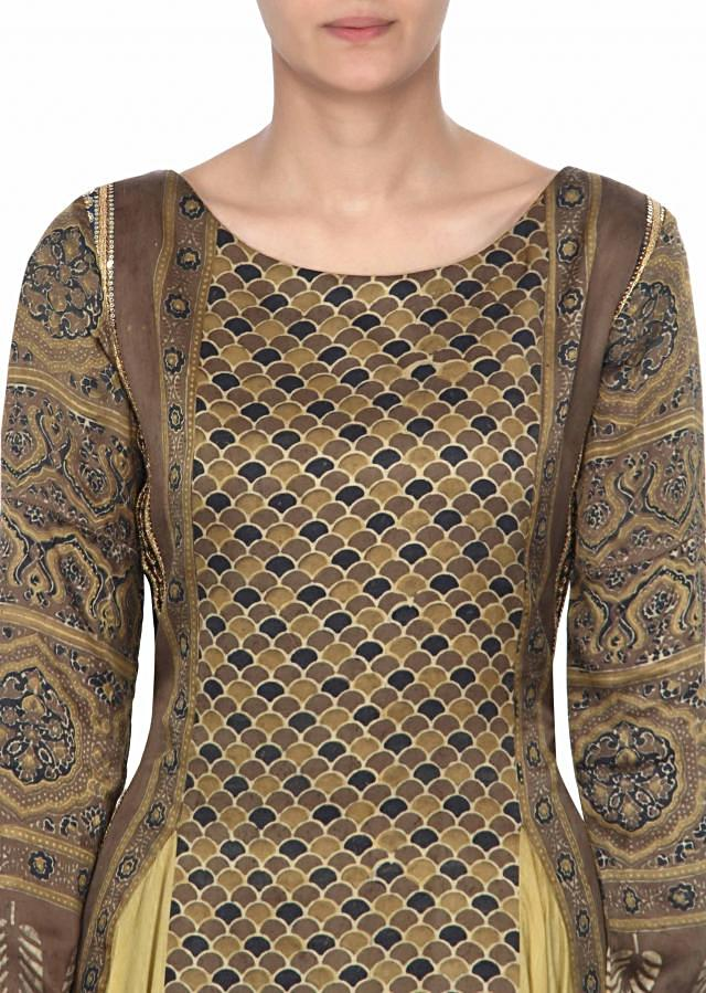 Featuring beige and olive printed suit only on Kalki
