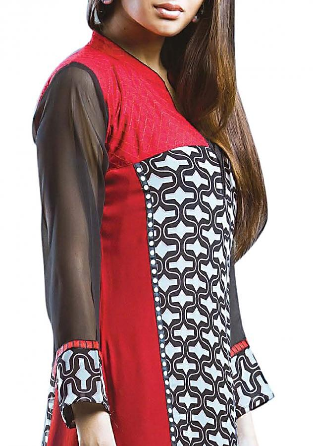 Black kurti featuring in printed georgette. Yoke is in red cotton with resham work in checks.
