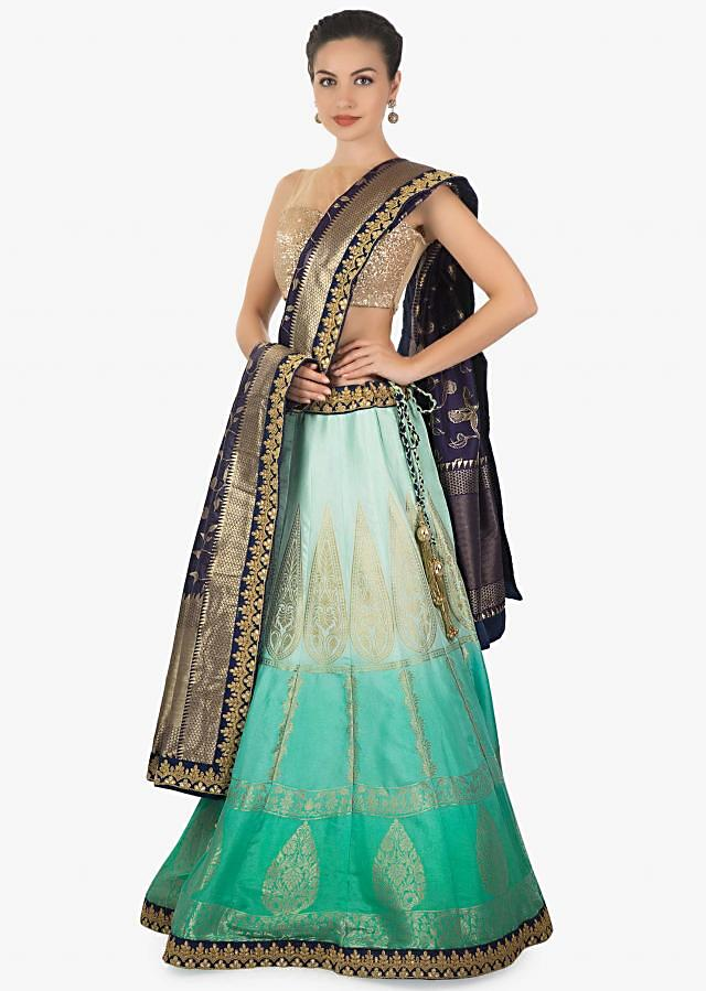 Featuring blue shaded brocade silk Lehenga with a navy blue brocade dupatta only on kalki