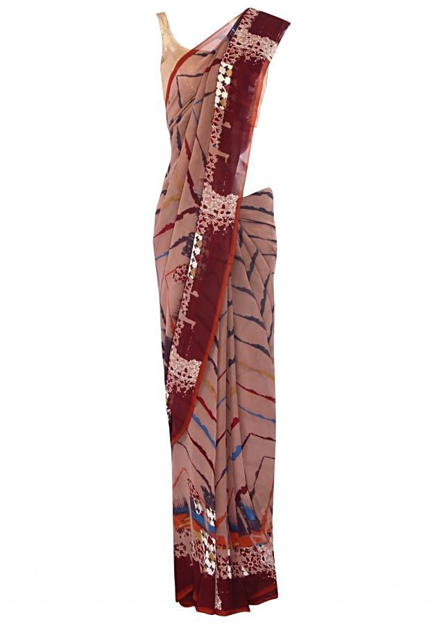 Featuring printed brown saree only on Kalki