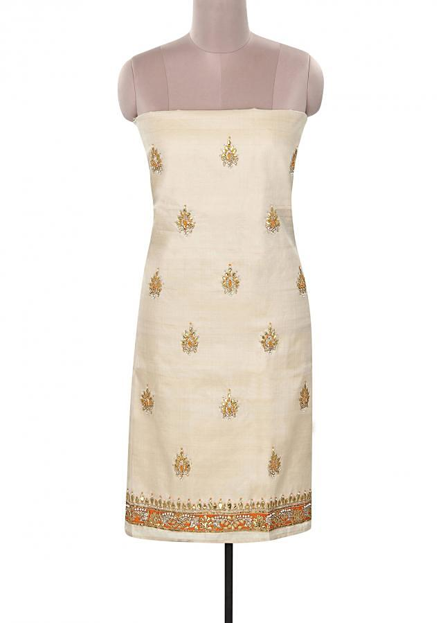 Featuring cream unstitched suit in tussar silk only on Kalki