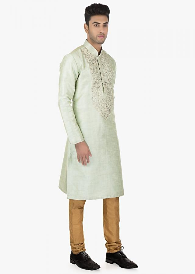 Featuring metal Grey silk kurta with a contrasting polyester silk Sandal Brown chudidar set only on kalki