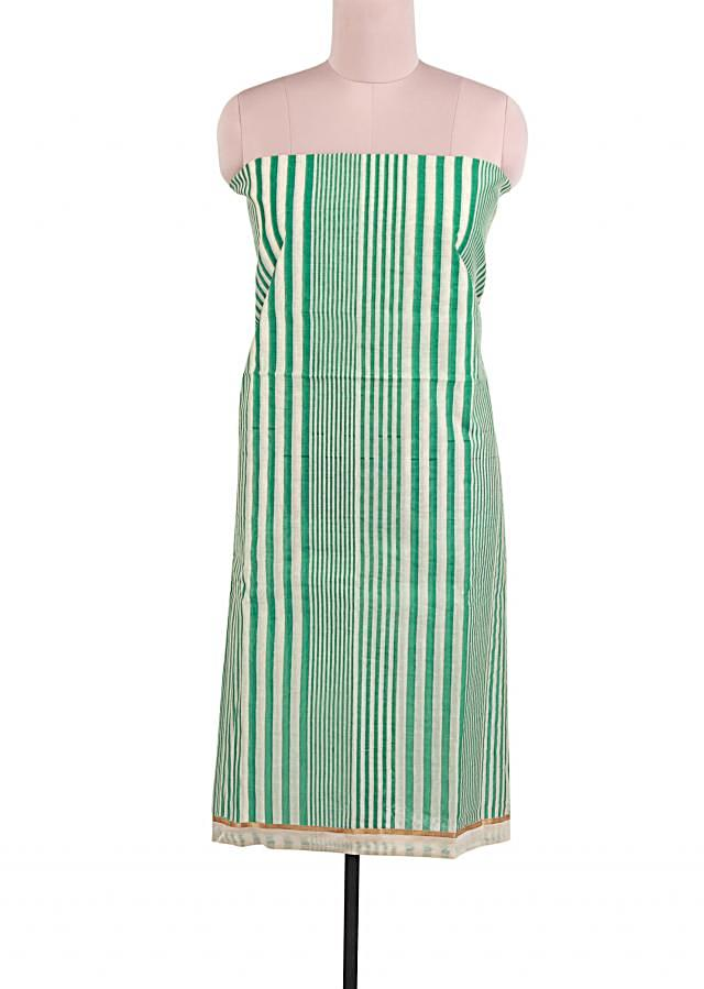 Featuring off white and green stripe unstitched suit  only on Kalki