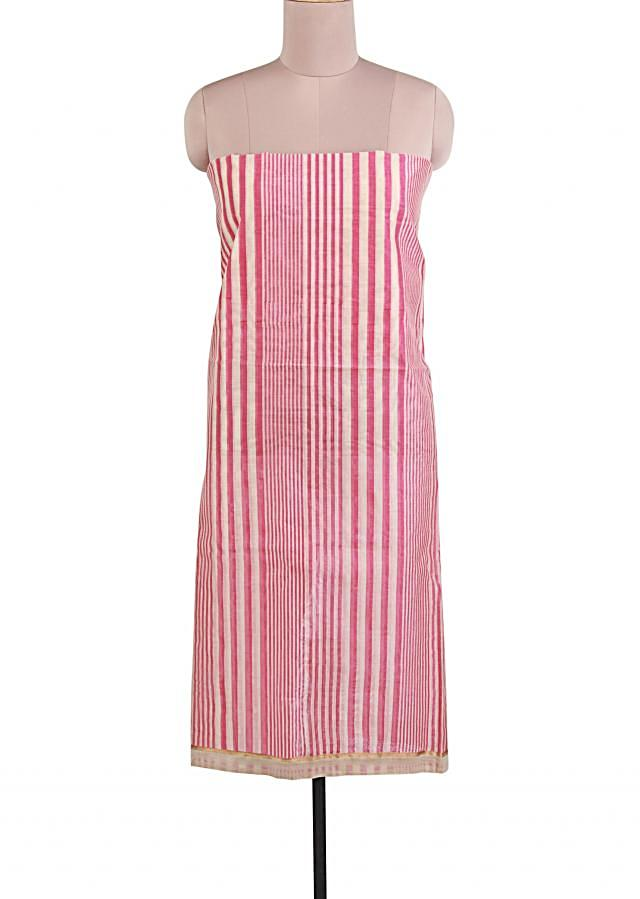 Featuring off white and pink stripe unstitched suit  only on Kalki