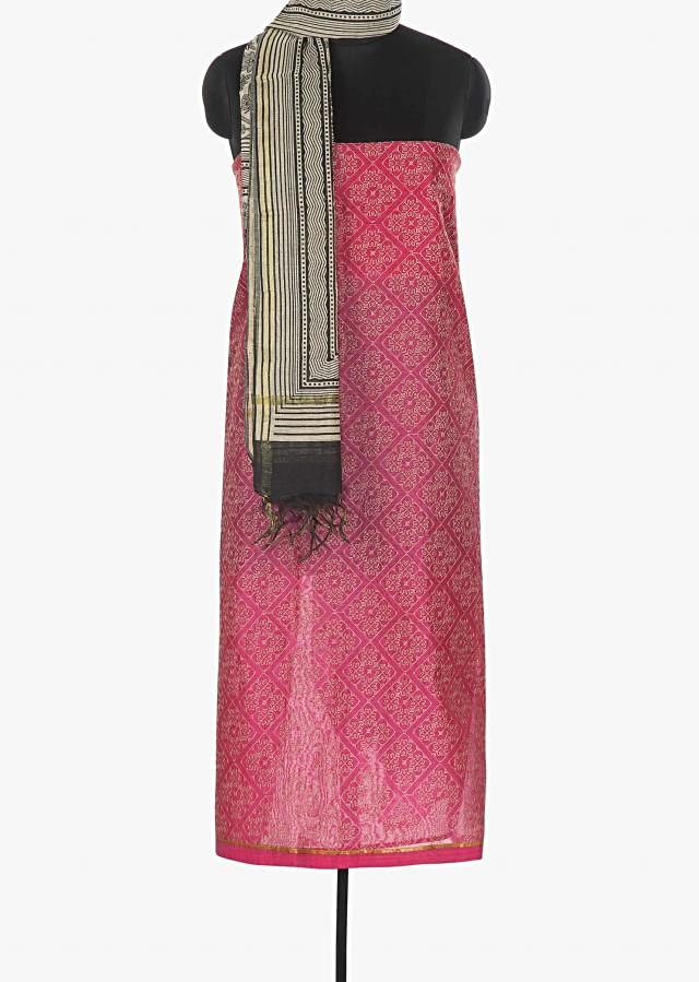 Featuring pink cotton suit enhanced with thread work in rhombus motifs only on Kalki
