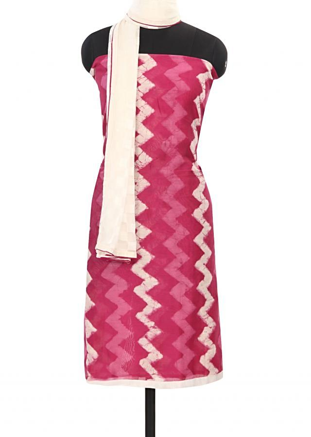 Featuring rani pink and cream unstitched printed suit only on Kalki