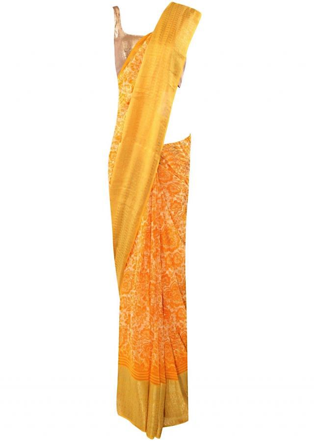 Featuring yellow self printed saree in weaved border only on Kalki