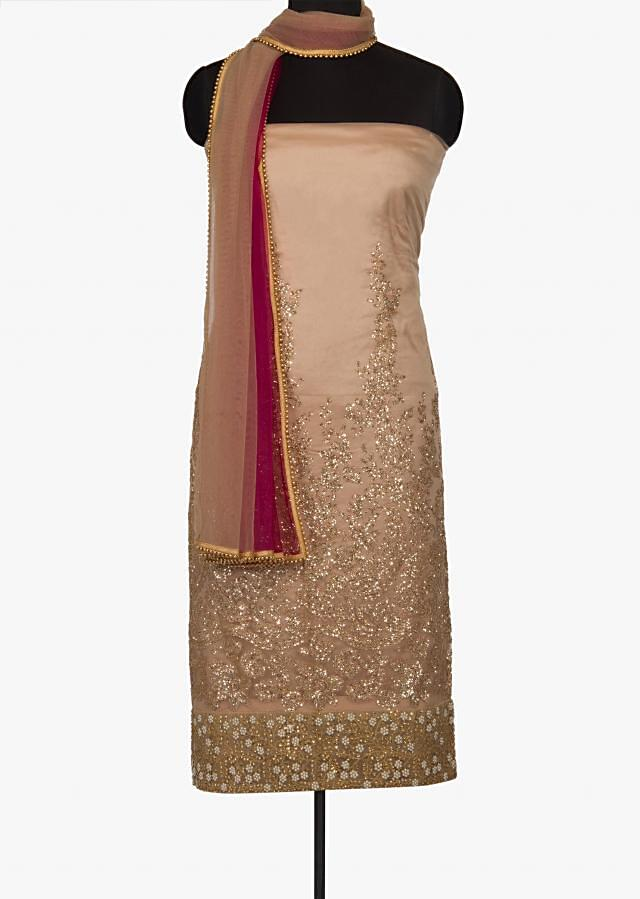 Featuring beige unstitched suit in net with sequin embroidery only on Kalki