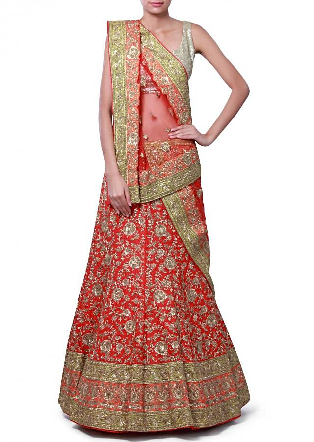 Featuring red unstitched lehenga adorn in sequin and zardosi embroidery only on Kalki