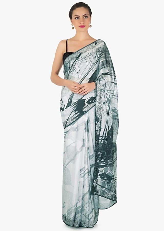 Featuring self printed saree in white and black crepe with kundan border only on Kalki