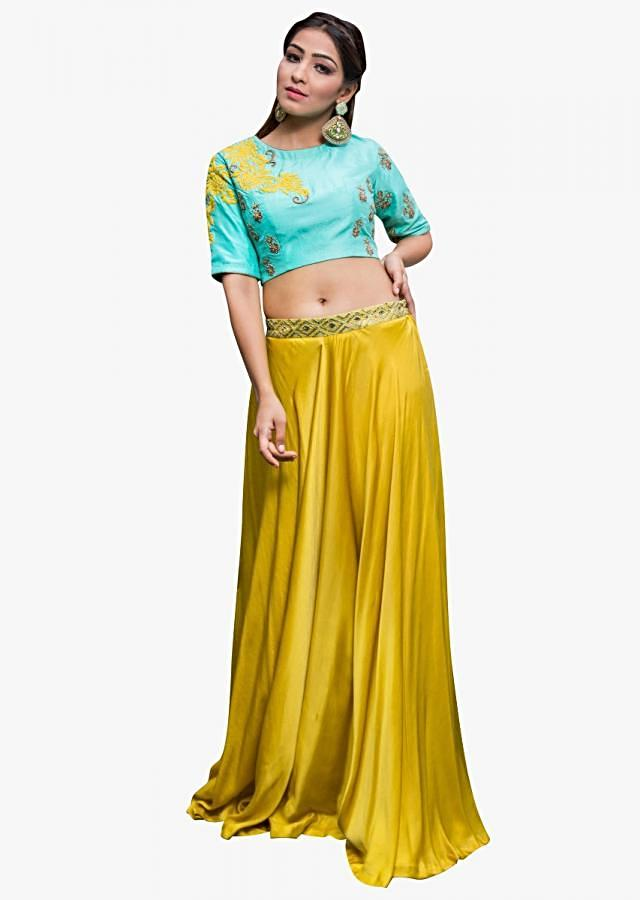 Featuring turq blue resham and zardosi embroidered crop top with mustard skirt