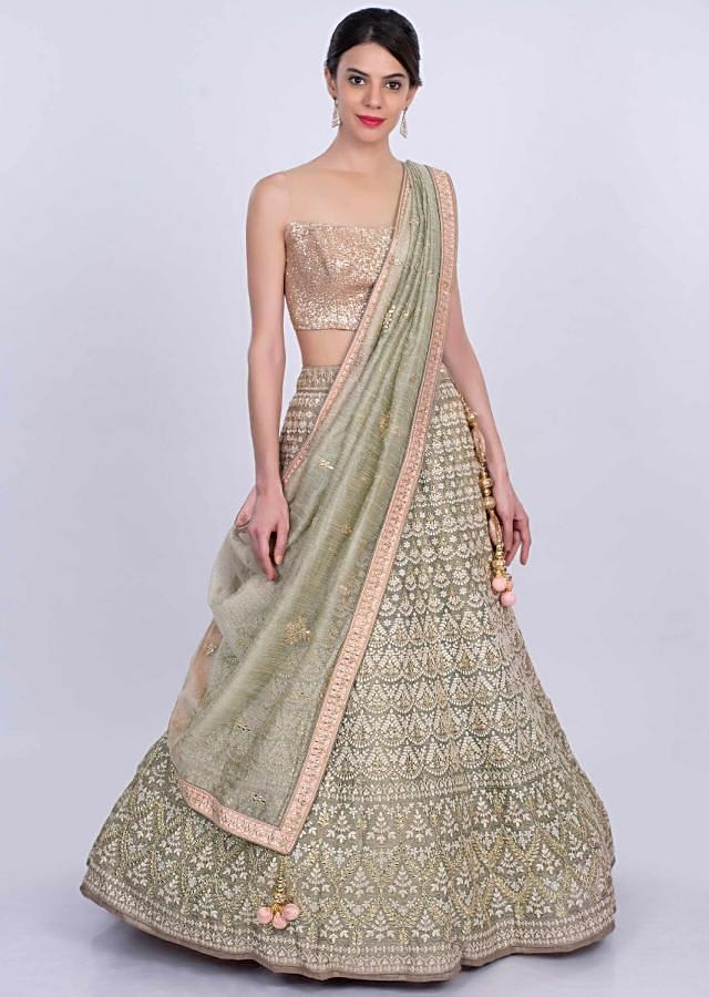 Fern green jute lehenga intricated in thread embroidery and butti only on Kalki