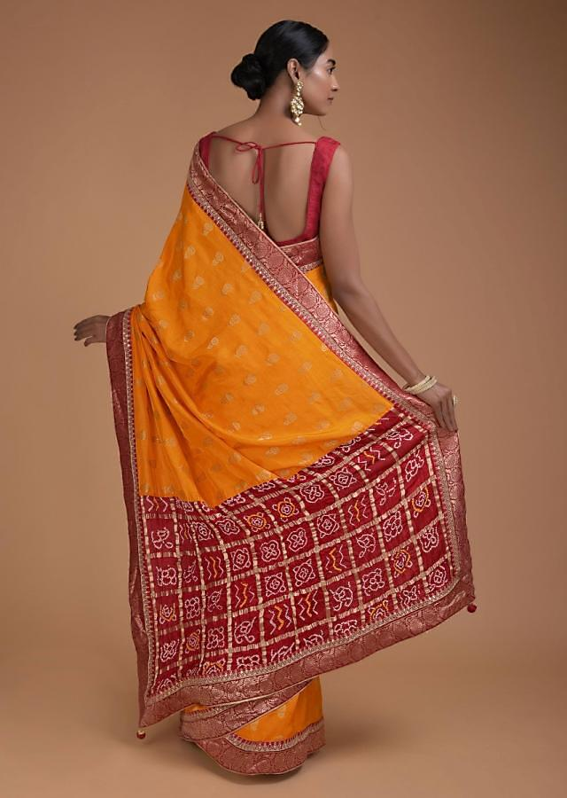 Fire Yellow Saree With Weaved Floral Buttis And Bandhani Printed Pallu Online - Kalki Fashion