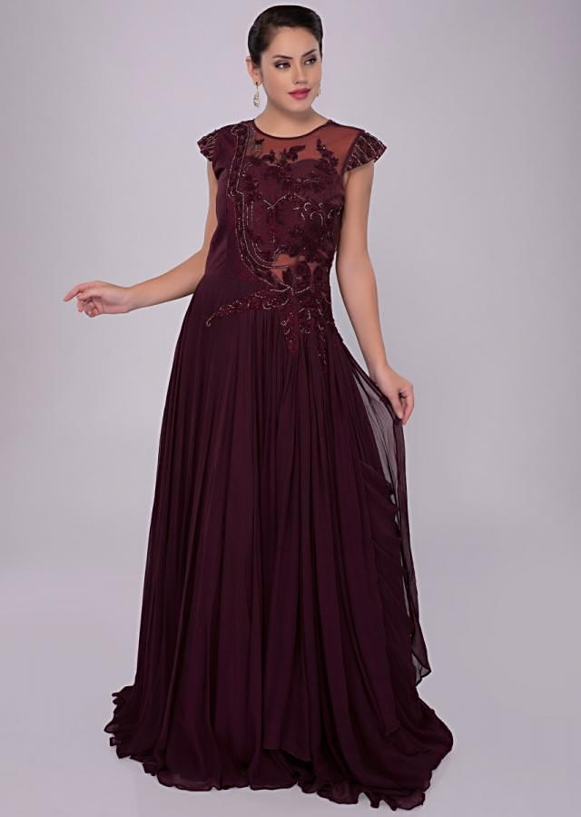 Floor length wine gown with raw silk and net embroidered bodice only on kalki