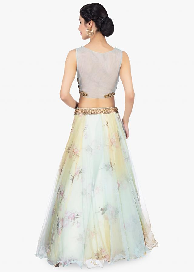 Floral printed organza lehenga with net top layer paired with a mint blouse and net dupatta only on Kalki
