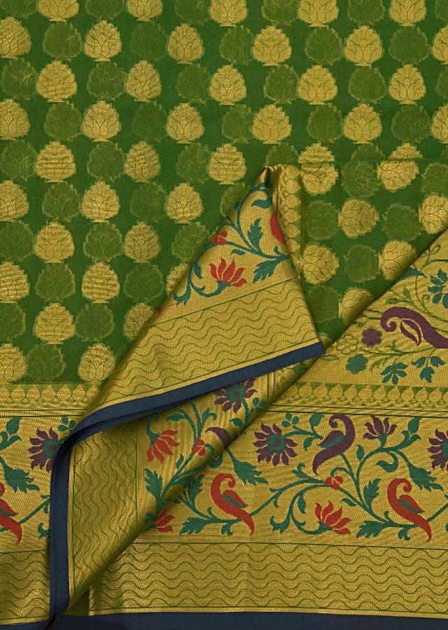 Forest green saree in silk with weaved butti and floral jaal at pallav border only on Kalki