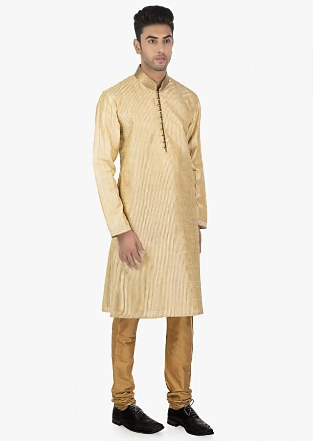 Frosted almond  Beige pin tuck silk kurta and Sandal Brown  chudidar set only on Kalki