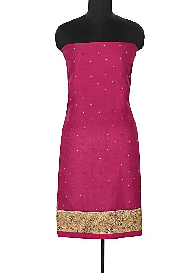 Fuchsia pink unstitched suit enhanced in printed zari border