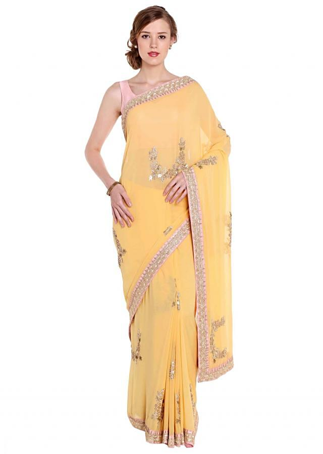 Georgette saree in yellow with necklace motif embroidery only on Kalki
