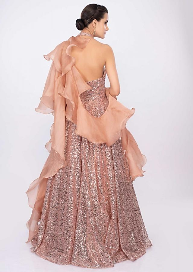 Giorgia Andriani in kalki peach halter neck sequins embroidered gown with ruffled side drape