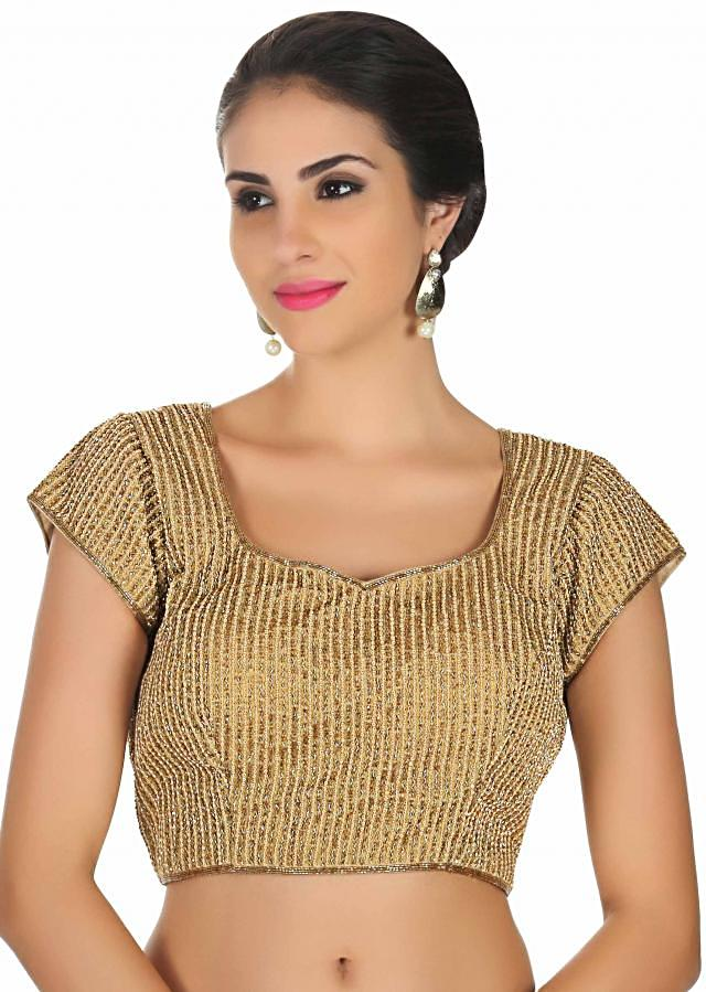 Gold blouse in silk with sequin and cut dana embroidery only on Kalki