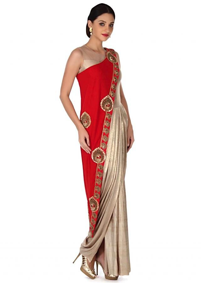 Gold dress matched with long red jacket only on Kalki