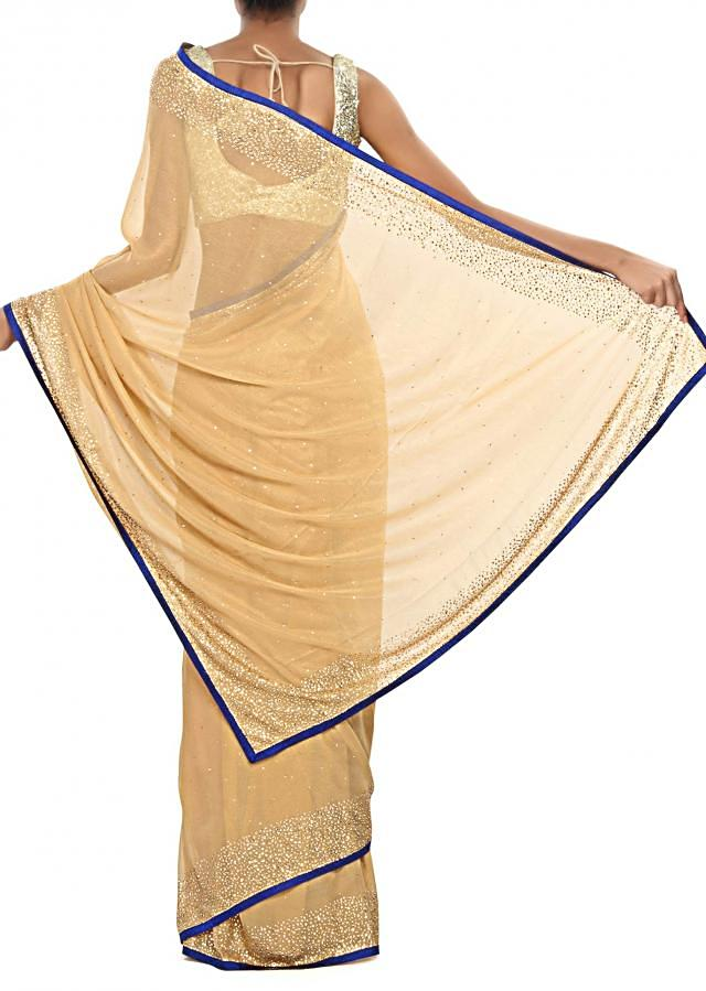 Ochre gold foil saree embellished in kundan embroidery only on Kalki