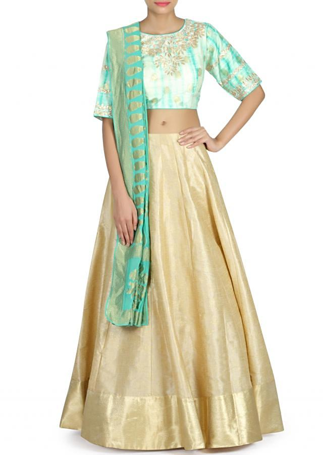 Gold lehenga matched with batik printed blouse only on Kalki