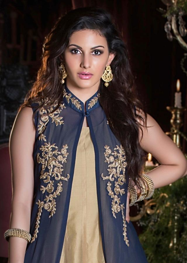 Gold long dress matched with navy blue long jacket in moti and cut dana work