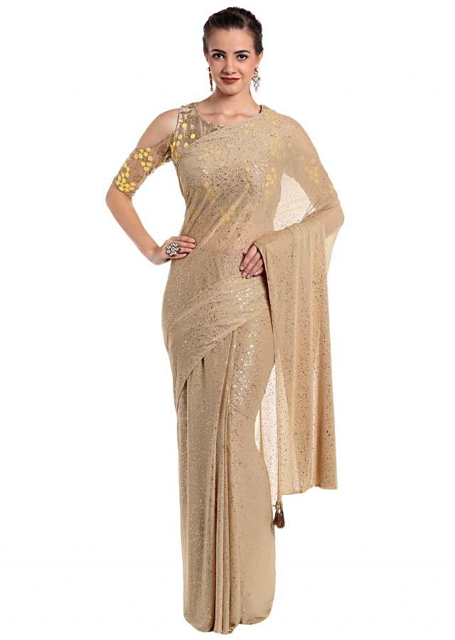 Gold lycra net saree crafted with thread and shimmer work only on Kalki