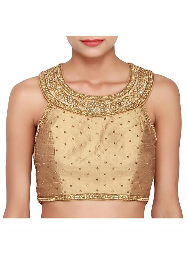 Gold raw silk blouse embellished in zardosi only on Kalki