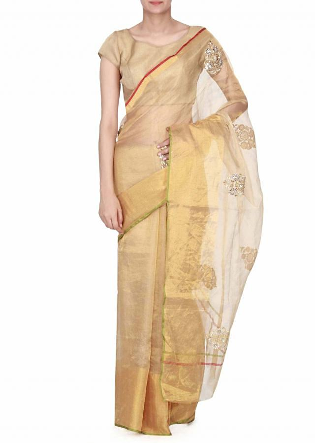 Gold saree adorn in gotta patch and zardosi butti only on Kalki