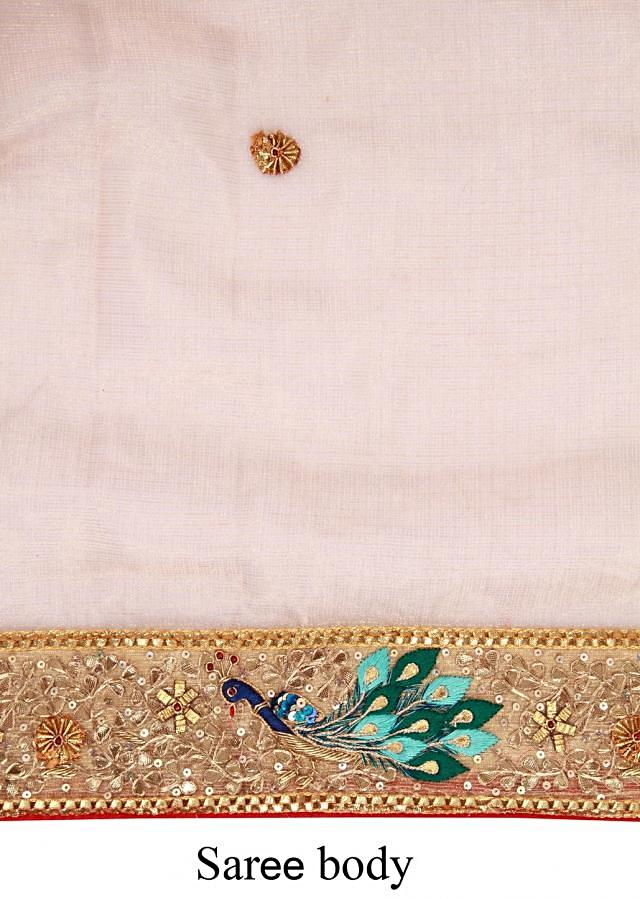 Gold saree adorn in peacock motif embroidery only on Kalki
