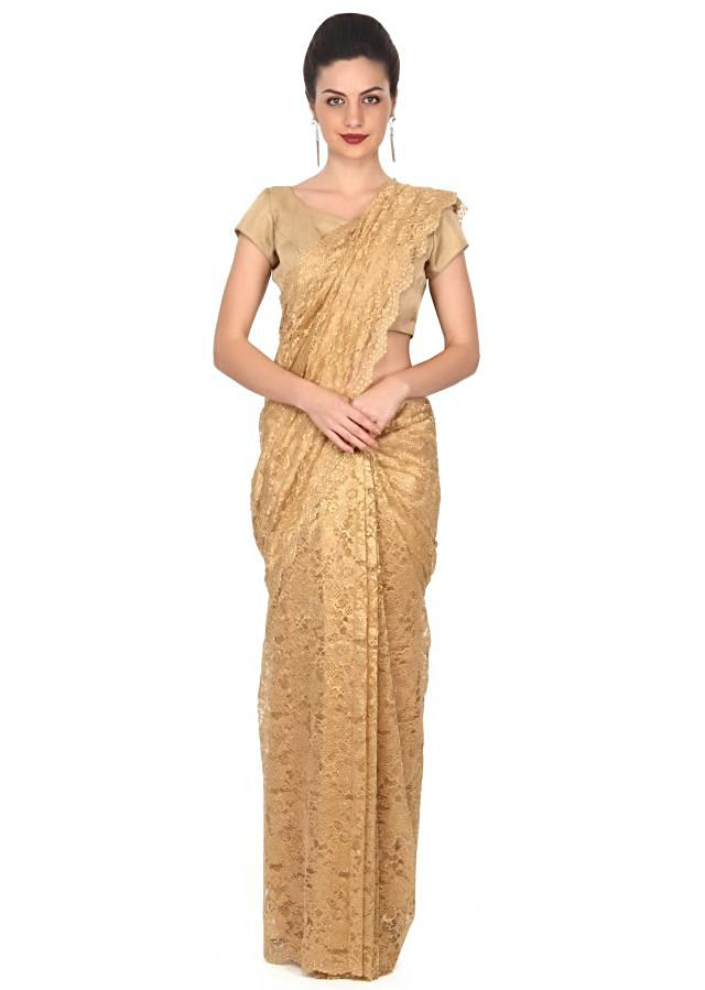 Gold saree featuring in chantilly with kundan work only on Kalki